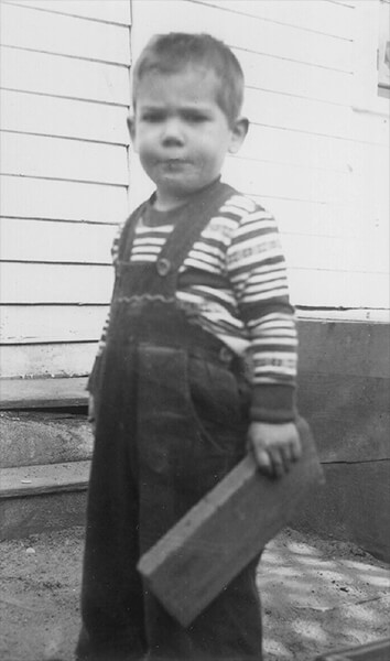 Lawrence Berndt at 3 years old - with board in hand